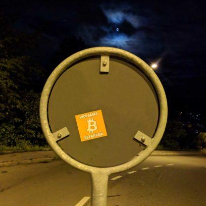 Bitcoin sticker on street sign