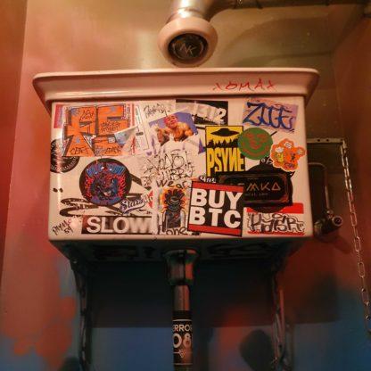 Bitcoin sticker on toilet