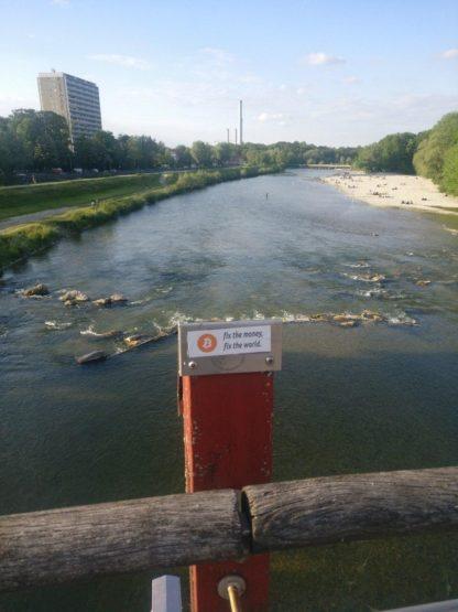 Bitcoin sticker over river