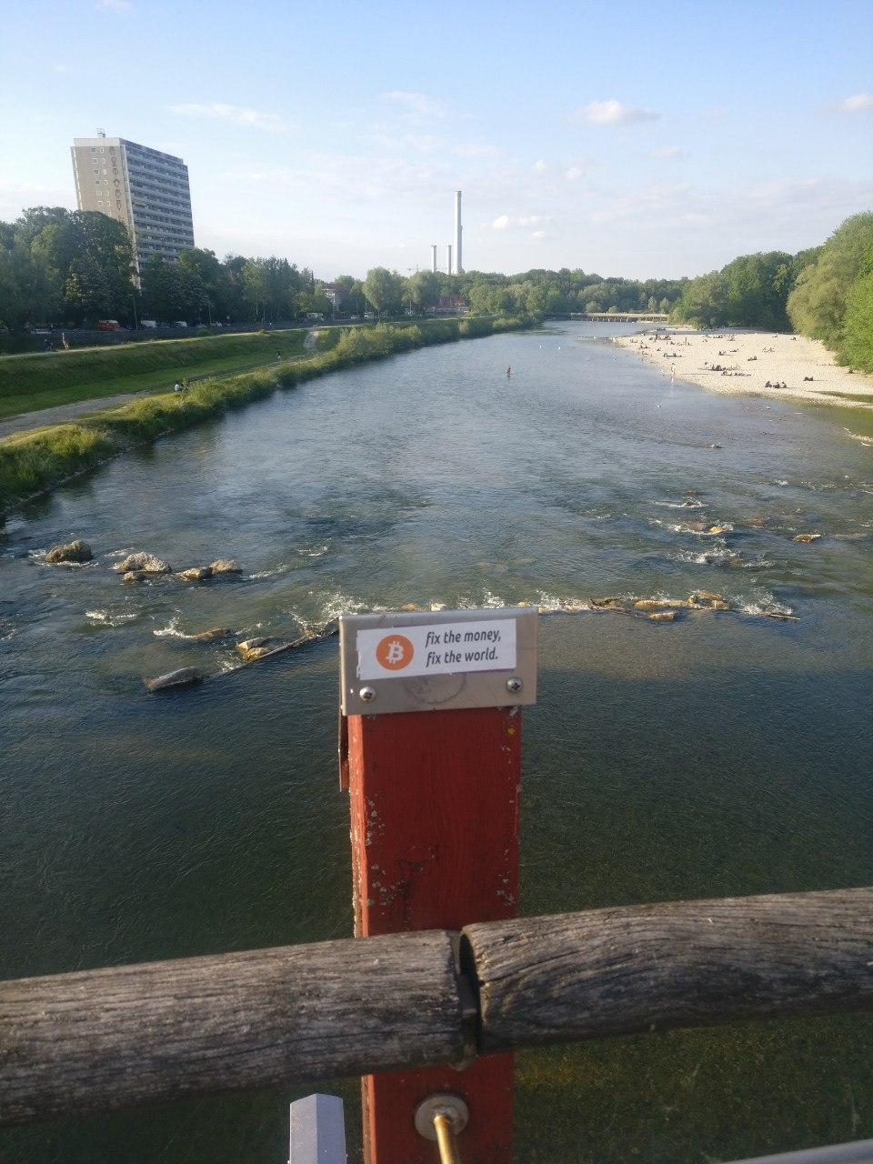 Bitcoin sticker over river